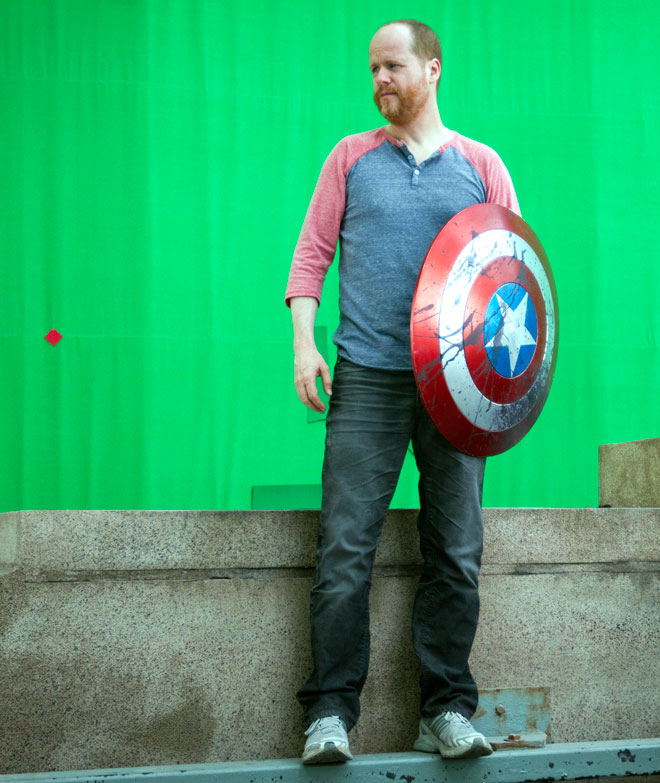 Joss Whedon with Captain America's shield